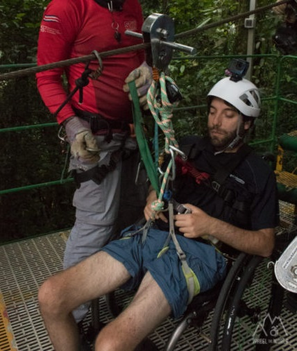 Wheelchair User attached to Zip Wire